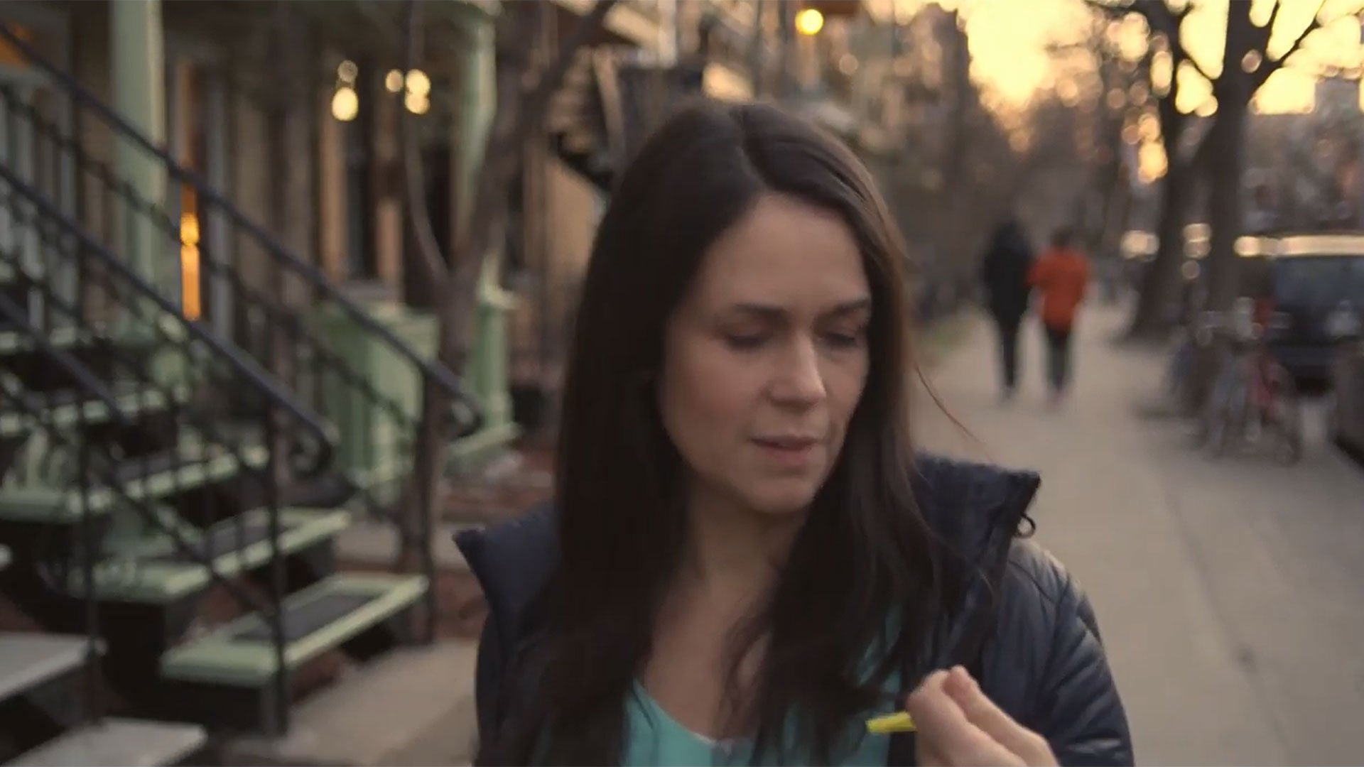 40 year old woman looking at key in the street